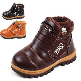 Wholesale Snow boots kids new fashion winter snow boots kids brown leather thick thick plush black girls snow boots boys snow boots