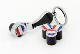 anti theft car dust caps NZ - France USA Germany flag Blue eye ball Earth Flower Car styling Spanner keychain Anti-theft Tire valve caps Carbon fiber Type air Dust Cover