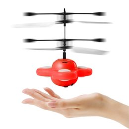 Chinese  LED RC Flying Ball Drone Helicopter Magic Flying Saucer Colorful Stage Lamp Infrared Hand Induced Floating Flight UFO Ball Toys manufacturers
