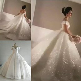 a9a4e7f38b0 Bling A-line Sequin Wedding Dresses Off-Shoulder Chapel Train Glitter Glued  Lace Real Image Cinderella Sexy Puffy Bridal Gowns