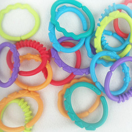 Baby S Beds NZ - 8 Pcs\u002Fset Rubber Rainbow Ring Molars Safety Grip Baby Toys Rattle Bed Stroller Hanging