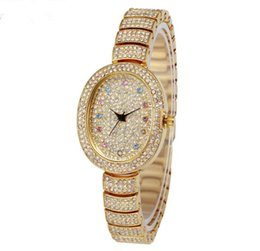 woman gold watches UK - Women Luxury dial Watch noble Christmas gift Full diamond Business waterproof alloy diamond high quality oval variable disk watch
