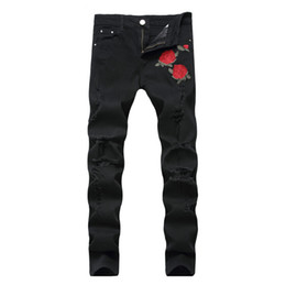 Chinese  Rose Embroidery Jeans High Quality Fashion Blue Black Ripped Male Pants Tide Slim Pants manufacturers