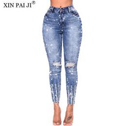 Venta al por mayor de Nuevo 2018 Primavera Verano elástico azul agujero rasgado Jeans Mujer Pantalones de mezclilla Pantalones para mujeres lápiz Skinny Jeans