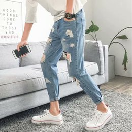 New Trend Casual Jeans Canada - 2018 Spring And Summer New Men's Jeans Blue Casual Slim Feet Fashion Wild Personality Hole Street Trend Harem Pants