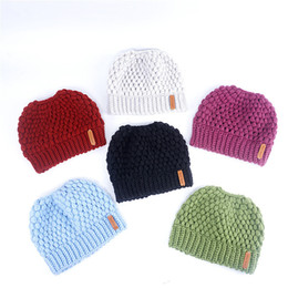 China 2018 Women Knitted Hat Autumn Winter Warm Ladies Horsetail Caps Hollow Out Hats Beanie Girls Designer Fashion Ponytail Caps cheap ladies winter beanies suppliers