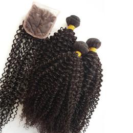 Wave Machine Hair China NZ - Curly #1b brazilian bundles full cuticle brazilian body wave hair Manufacturing China 100% virgin bundles with Swiss lace closure