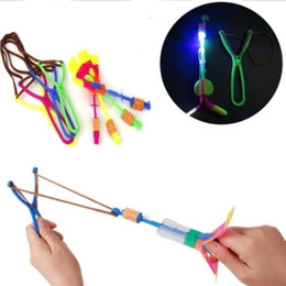 Discount wholesale slingshot led - Novelty Children Toys Amazing LED Flying Arrow Helicopter umbrella for Sports Funny Slingshot birthday party supplies ki