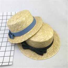 Wholesale Sun Flat Straw Hat Boater Hat Girls Bow Summer Hats for Women  Beach Flat Panama Straw Chapeau Femme dfc249fd8acd