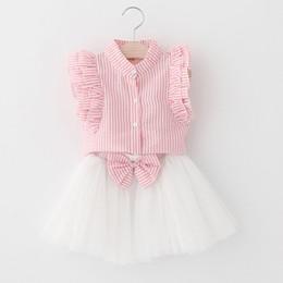 3d44798565ba9 Vêtements d été de fille au détail ensembles chemise à rayures manches  évasées + jupe gaze arc deux pièces de mode tenues vêtements pour enfants