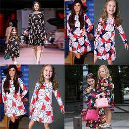 Christmas Family Matching Dresses Mother Daughter Long Sleeve Outfits Red  Santa Candy Biscuits Man Xmas Bell Snowman Presents Plaid Dress de6c2e6bebbf