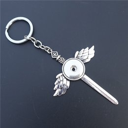 $enCountryForm.capitalKeyWord NZ - Sword Cross Wing Keychain Noosa Chunks Metal 18 mm Snap Buttons Socket Keyrings Jewelry Unisex Jewelry