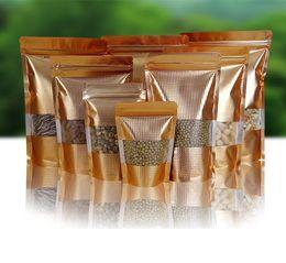 Gold Stand Up Mylar Bolsas con cierre de cremallera y ventana Papel de aluminio que se puede volver a sellar Envase de alimentos Sellado Encapsulado Caramelos dulces Bocadillos de embalaje en venta