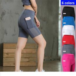 2017 sexy pantaloncini da yoga di marca pantaloncini sportivi da donna con tasca traspirante atletica corsa fitness all'aperto palestra pantaloncini da ginnastica compressione XXL