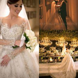 Luxueux Dubaï arabe une ligne robes de mariée en dentelle appliques perles paillettes cristaux illusion bouton dos pure manches longues robe de mariée