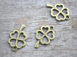 Lucky cLover charms online shopping - 25pcs Four Leaf charms Antique Bronze Filigree Four Leaf Clover Lucky Flower Charms pendants jewelry supplies