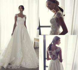 $enCountryForm.capitalKeyWord NZ - Riki Dalal 2018 Beach Wedding Dress With Lace Sequined Appliqued Cap Sleeve Floor Length Satin Bridal Dress Cheap Plus Size Wedding Gowns