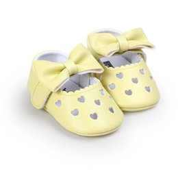 Soft Soled Shoes Australia - Wholesale Cheap Baby Girl Shoes PU Moccasins Toddler Shoes Princess Bow Soft Soled Non-slip Love Heart Hole Footwear Crib Shoes 0-18M