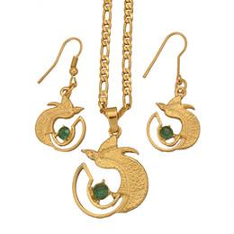 Vente en gros Boucles d'oreilles collier couleur or PNG avec pierre verte pour les femmes, Papouasie-Nouvelle-Guinée beaux bijoux oiseau # 109406