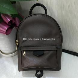013d3233558 ¡El mejor precio de alta calidad! Original diseño de cuero genuino mini  mujeres bolsa niños mochila de lujo famosa moda Springs Palm 41560 41561