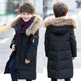 fe733f0f890 Teenage 2018 Boy Parkas Children Winter Warm Jackets Coast Boy s Down Jacket  Long Thick kids Clothes Coat Raccoon Fur Hooded Y18102608