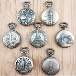 $enCountryForm.capitalKeyWord NZ - 100pcs Vintage Bronze Paris Tower Quartz Pocket Watch Hollow Pendant Long Chain Women's And Men's Clock Fob Watch Wholesale