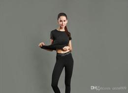 Venta al por mayor de Pantalones de yoga, pantalones de mujer, pantalones ajustados para correr, entrenamiento físico, leggings de entrenamiento, estiramiento de secado rápido, transpirable, 2017 nuevos