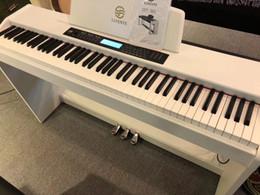 Venta al por mayor de Gabinete vertical piano eléctrico 88 teclas martillo profesional inteligente para adultos en el hogar jardín de infantes maestro niños principiante acero electrónico