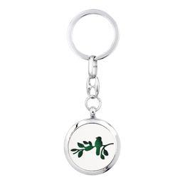 $enCountryForm.capitalKeyWord NZ - Bird Cat Lotus Key ring Perfume Aromatherapy Essential oil Diffuser Locket Key chain Alloy 30mm Hollow Locket Silver with 5pads randomly