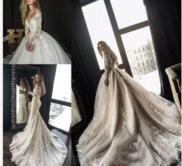 Vente en gros 2018 Robes de mariée sirène de designer magnifique avec détachable train arabe Dubaï hors l'épaule manches longues en dentelle de mariage robes de mariée