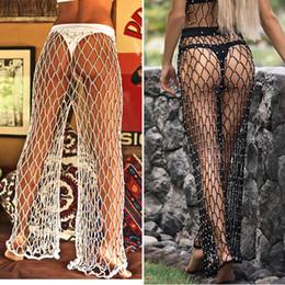 00546c177a Crochet Hollow-Out Wide Leg Pants Sexy Bikini Swimwear Casual Women Beach  Sunscreen Cover Trousers