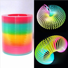Discount magic spring slinky Magic Kids Toy Large Magic Plastic Slinky Rainbow Spring Colorful Funny Classic Toy For Children Gift 8.7*9cm