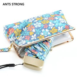 nylon coating Canada - ANTS STRONG mini pocket five-folding umbrellas Creative buckle bag printing umbrella color coating arasol