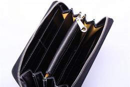 Vente chaude Nouvelle mode Hommes Femmes d'embrayage Simple fermeture éclair Portefeuille GY en cuir long paragraphe portefeuille en Solde