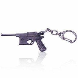 $enCountryForm.capitalKeyWord UK - Online Game FireWire AK47CF gun model key chains gun charms christmas gifts Bag Hanging Ornament Car Keyring