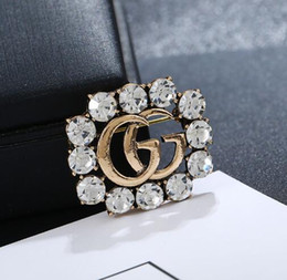 541229a300f Luxury Brand Letters Brooch Pins Crystal Rhinestone Hollow Letters Cprsage  Scarf Buckle Women Girl Suit Shirt Accessories Jewelry