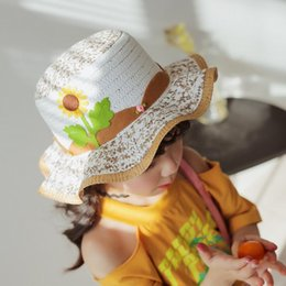 girls straw bucket hats NZ - 6 Color nice breathable children straw hat with cartoon sunflower creative baby hats girls bucket hat kids beach hat Wavy edge cap free ship