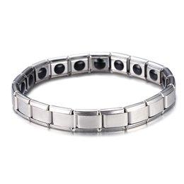 Venta al por mayor de Color plata acero inoxidable elástico turmalina cadenas de energía enlace pulsera salud cuidado de la salud para mujeres hombres pulseras de energía germanio