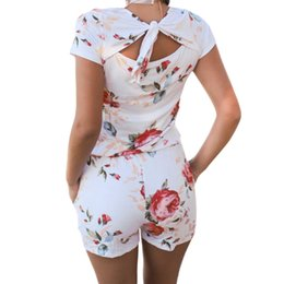 ebd740fc108d Sexy Back Knot Playsuits Floral Print Rompers 2018 Casual Women Shorts  Jumpsuits Femme Short Sleeve Summer Beach Overalls GV826