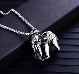 nuevo colgante de collar de elefante africano inoxidable colgante por  tendencia de moda colgante de los hombres europeos y americanos 0b24b8d77c4