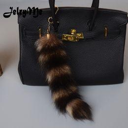 37967c53e5 25CM Length Real Raccoon Fur Stripe Tail Keychain Charms Women Handbag  Pendant Pompom Key Rings Car Styling Tassel Key Chians