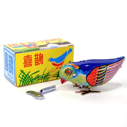 Chegada nova Vintage Enrolar Magpie Pássaro Bicando Estanho Brinquedo Mecânico Bicando Para Crianças em Promoção