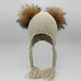 f37ceb021a3 2019 New Winter Warm Beanies For Kids With 2 pcs Raccoon Pompom Knitted  Hats Genuine Fur Pom pom Cap Kids Baby Hats Protect Ears