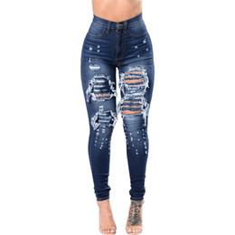 f6a02e892c Las mujeres pantalones vaqueros azul oscuro 2018 moda de verano agujero  rasgado ahueca hacia fuera flaco estiramiento de talle alto Vintage lápiz  pantalones ...