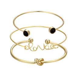 1a576ff10958 Moda nudo brazalete pulseras de oro color de la aleación de metal de moda  palabra amor brazalete de las mujeres joyería Bijoux accesorios