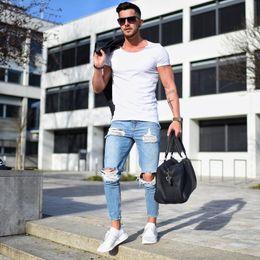 63adc6d9944 2018 Nuevos hombres con agujeros rasgados jeans Zip skinny biker jeans azul  con plisado patchwork slim fit hip hop hombres pantalones S-4XL