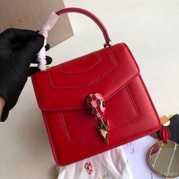 Tone model online shopping - The latest Lightning Hanging Organ Bag Snake Head Bucket Black Gem Removable Shoulder Belt Handbag Model