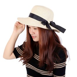 white floppy hats NZ - 2017 New arrival Style Summer Women Folding Beach UV Cap Wide Brim Bowknot Floppy Straw Sun Hat Caps