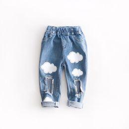China New Spring Autumn Boys Girls Jeans Pants Baby Kids Cartoon Cloud Broken Hole Design Denim Pants Children Casual Jeans Troulders 13658 cheap cartoon color pencil suppliers