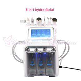 Ingrosso 6 in 1 hydradermabrasion + scrubber di pelle + RF + martello di raffreddamento + ultrasuoni + ossigeno spray spa viso macchina